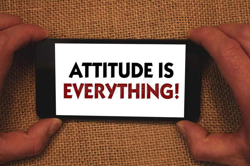 Writing note showing Attitude Is Everything. Business photo showcasing Personal Outlook Perspective Orientation Behavior Man hold. Ing cell phone white screen stock photography