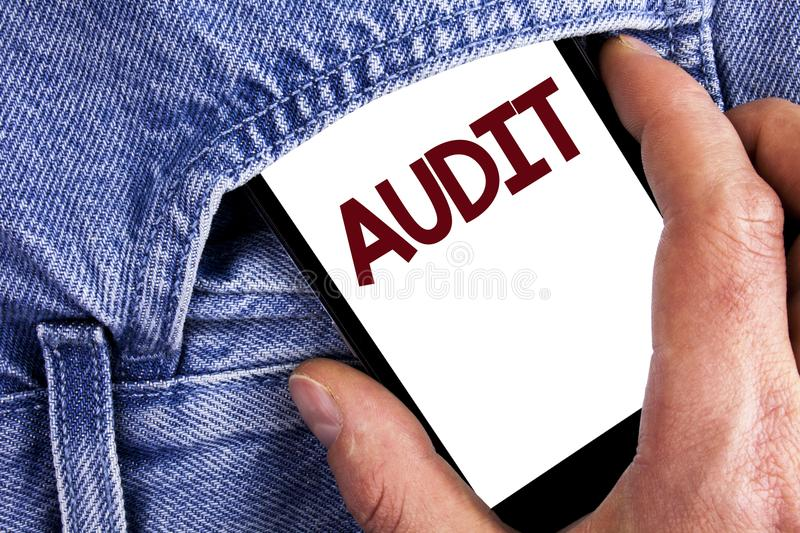 Writing note showing Audit. Business photo showcasing Local company auditors perform their financial investigation annually writt. En Mobile phone screen holding stock image