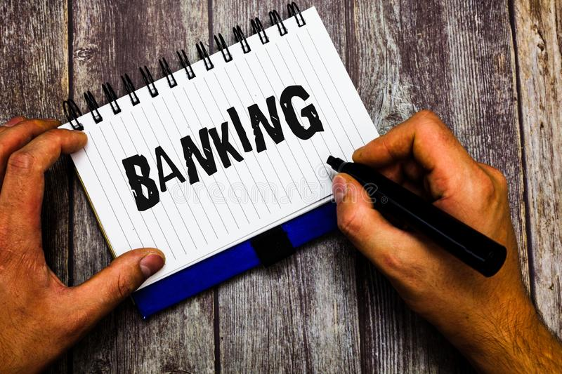Writing note showing Banking. Business photo showcasing Business conducted or services offered by bank Finance related.  stock photography