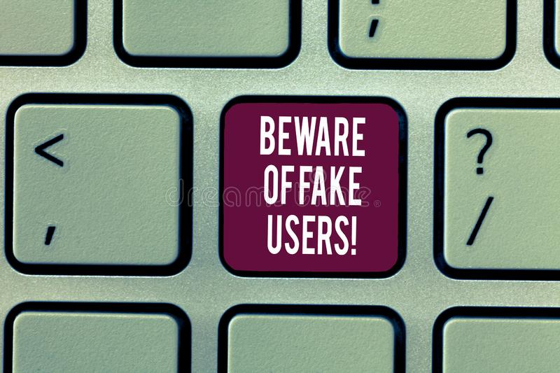 Writing note showing Beware Of Fake Users. Business photo showcasing Be aware of safety and danger in online. Communications Keyboard Intention to create royalty free stock photo