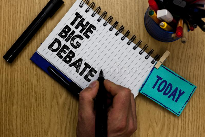 Writing note showing The Big Debate. Business photo showcasing Lecture Speech Congress presentation Arguments Differences Man hold. Ing marker notebook stock photography