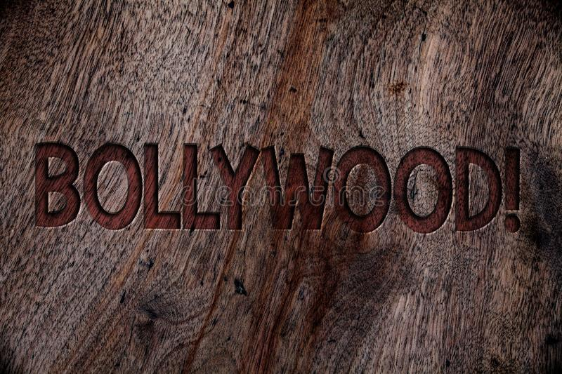 Writing note showing Bollywood Motivational Call. Business photo showcasing Hollywood Movie Film Entertainment Cinema Wooden back. Ground vintage wood board wild royalty free stock photo