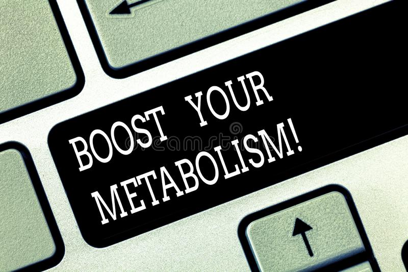 Writing note showing Boost Your Metabolism. Business photo showcasing Speeding up the breakdown of food calorie intake. Keyboard key Intention to create stock photography