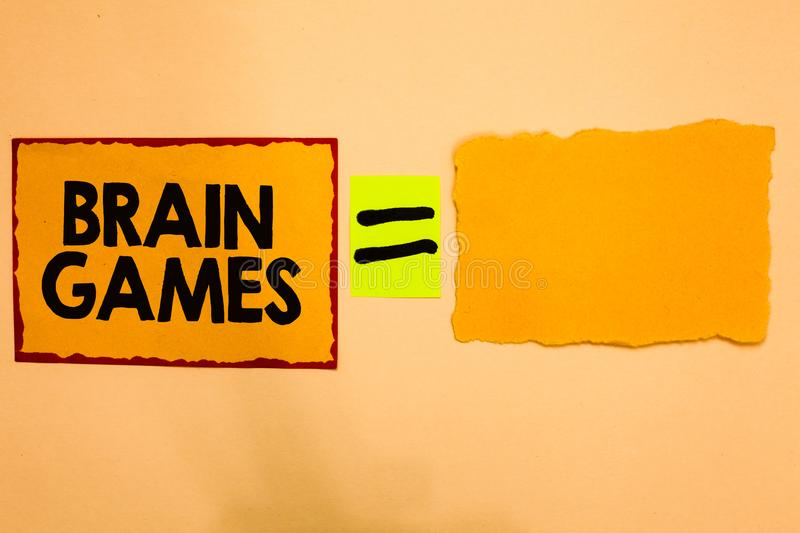 Writing note showing Brain Games. Business photo showcasing psychological tactic to manipulate or intimidate with opponent Orange. Paper notes reminders equal royalty free stock photos