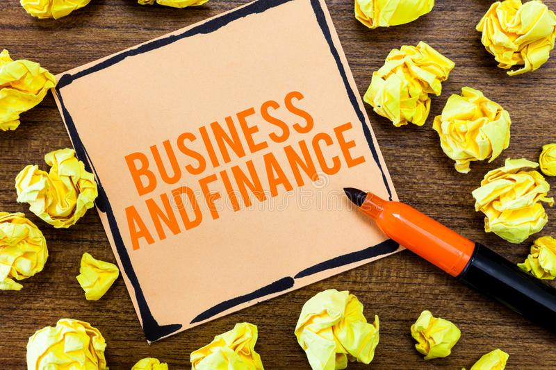 Writing note showing Business And Finance. Business photo showcasing Management of Asset Money and Fund of a company.  stock photography