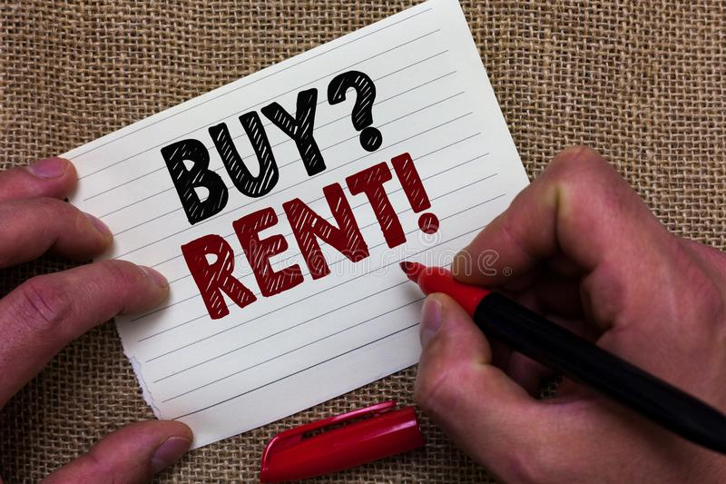 Writing note showing Buy question Rent. Business photo showcasing Group that gives information about renting houses Man's hand ho. Ld white paper with symbolic royalty free stock photos