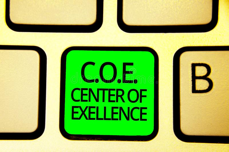 Writing note showing C.O.E Center Of Excellence. Business photo showcasing being alpha leader in your position Achieve Keyboard gr. Een key Intention computer royalty free stock photo