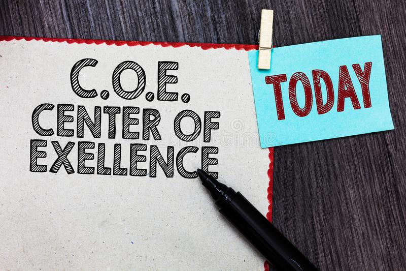 Writing note showing C.O.E Center Of Excellence. Business photo showcasing being alpha leader in your position Achieve White page. Red borders marker clothespin royalty free stock photos