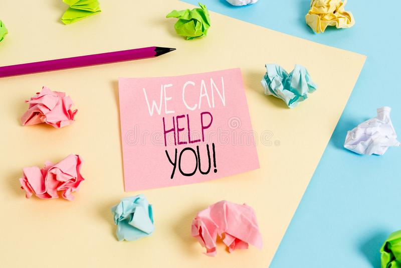 Writing note showing We Can Help You. Business photo showcasing offering good assistance to customers or friends Colored. Writing note showing We Can Help You stock image