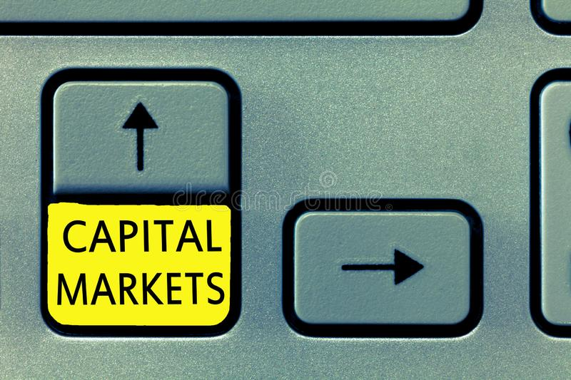 Writing note showing Capital Markets. Business photo showcasing Allow businesses to raise funds by providing market security.  royalty free stock photo