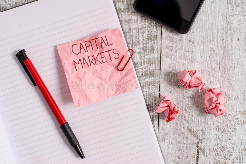 Writing note showing Capital Markets. Business photo showcasing Allow businesses to raise funds by providing market. Writing note showing Capital Markets stock photos