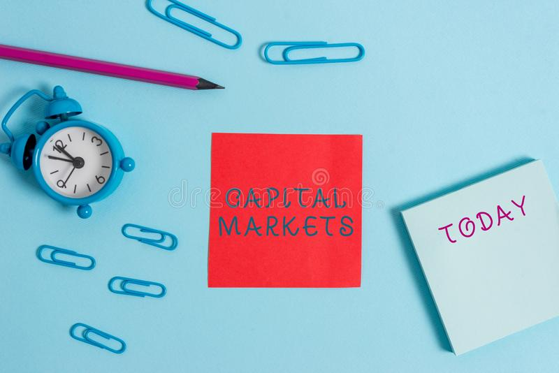 Writing note showing Capital Markets. Business photo showcasing Allow businesses to raise funds by providing market. Writing note showing Capital Markets royalty free stock photography