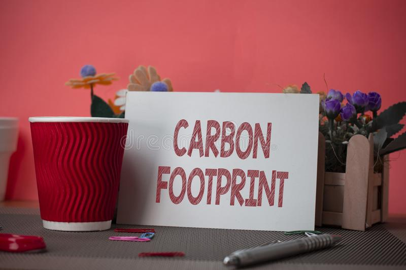Writing note showing Carbon Footprint. Business photo showcasing amount of dioxide released atmosphere result of. Writing note showing Carbon Footprint. Business royalty free stock photography