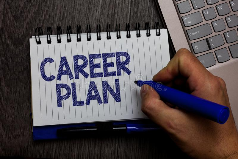 Writing note showing Career Plan. Business photo showcasing ongoing process where you Explore your interests and abilities Man hol. Ding marker spiral notebook stock image
