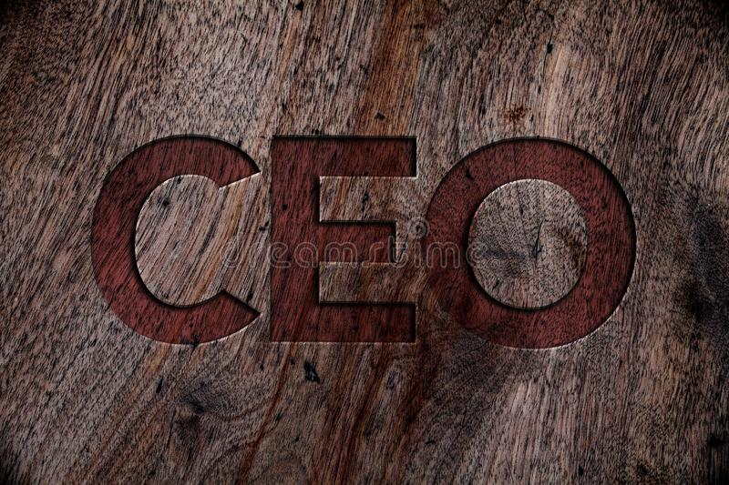 Writing note showing Ceo. Business photo showcasing Chief Executive Officer Head Boss Chairperson Chairman Controller Wooden back stock illustration