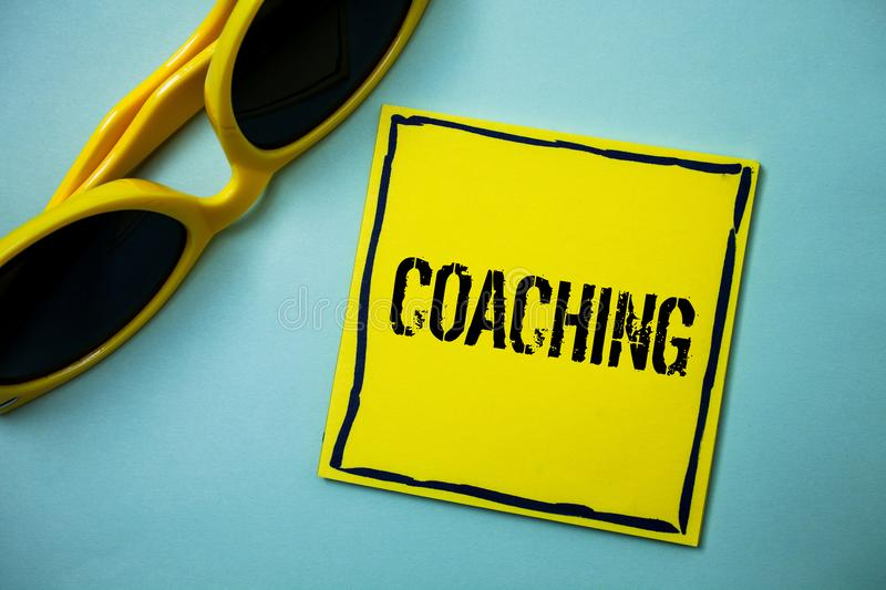Writing note showing Coaching. Business photo showcasing Prepare Enlightened Cultivate Sharpening Encourage Strenghten Ideas mess. Ages blue background stock photography