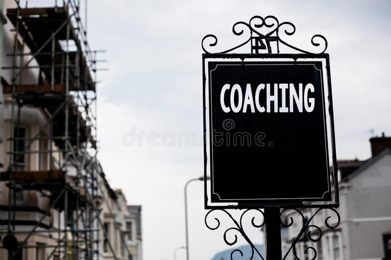 Writing note showing Coaching. Business photo showcasing Prepare Enlightened Cultivate Sharpening Encourage Strenghten Vintage bl. Ack board sky old city ideas royalty free stock images