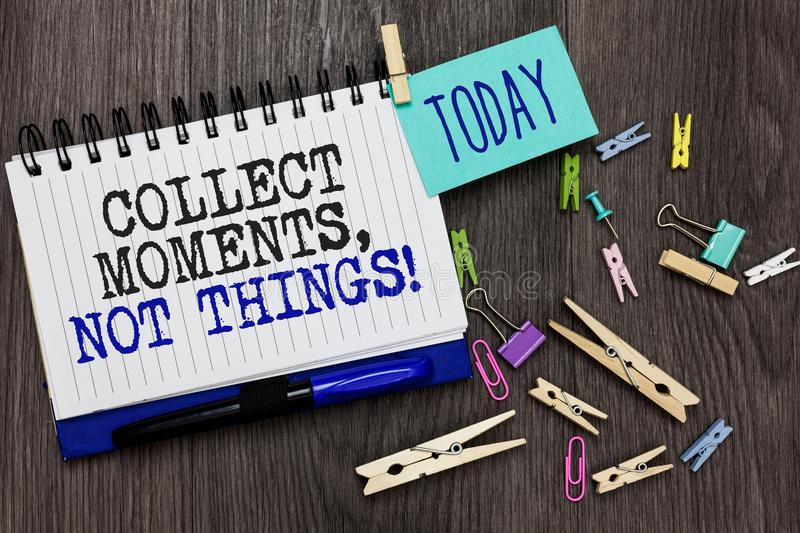 Writing note showing Collect Moments, Not Things. Business photo showcasing Happiness philosophy enjoy simple life facts Different. Paperclip on woody table royalty free stock images