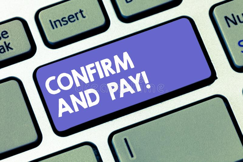 Writing note showing Confirm And Pay. Business photo showcasing Check out your purchases and make a payment Confirmation. Keyboard key Intention to create royalty free stock photos