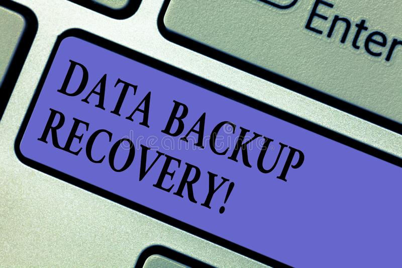 Writing note showing Data Backup Recovery. Business photo showcasing the process of backing up data in case of a loss. Keyboard key Intention to create computer stock photo