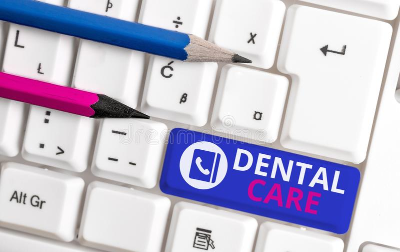 Writing note showing Dental Care. Business photo showcasing maintenance of healthy teeth or to keep it clean for future. Writing note showing Dental Care royalty free stock image