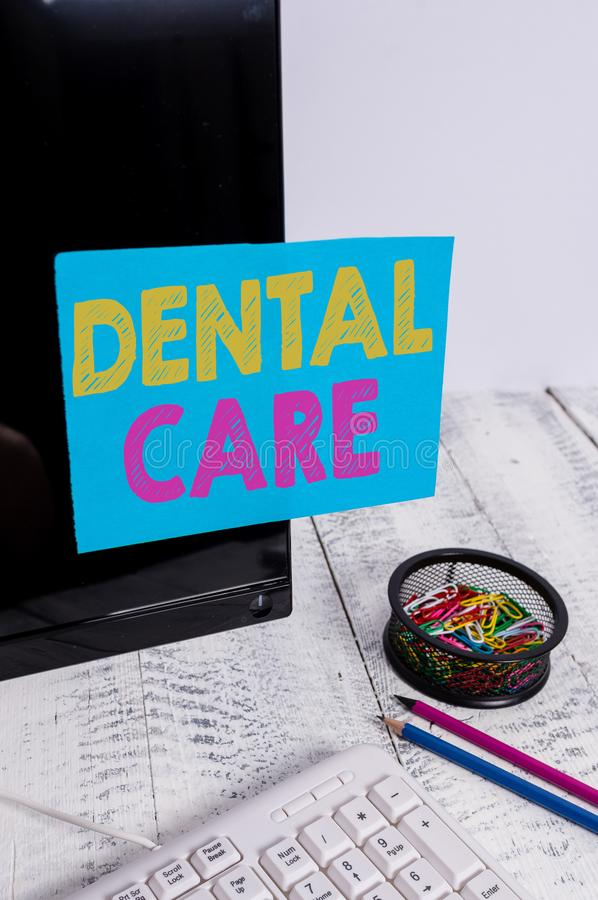 Writing note showing Dental Care. Business photo showcasing maintenance of healthy teeth or to keep it clean for future. Writing note showing Dental Care stock photo