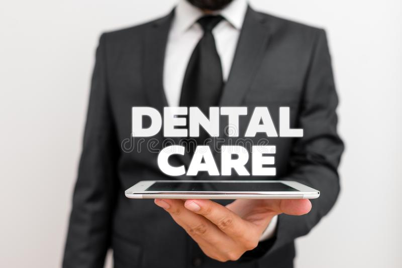 Writing note showing Dental Care. Business photo showcasing maintenance of healthy teeth or to keep it clean for future. Writing note showing Dental Care royalty free stock photography