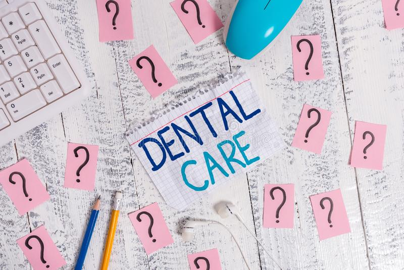 Writing note showing Dental Care. Business photo showcasing maintenance of healthy teeth or to keep it clean for future. Writing note showing Dental Care royalty free stock images