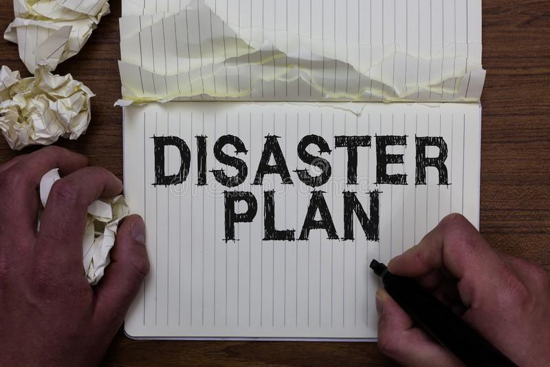Writing note showing Disaster Plan. Business photo showcasing Respond to Emergency Preparedness Survival and First Aid Kit Man hol. Ding marker notebook crumpled stock photography