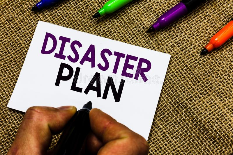 Writing note showing Disaster Plan. Business photo showcasing Respond to Emergency Preparedness Survival and First Aid Kit Man han. D holding marker white paper royalty free stock photography