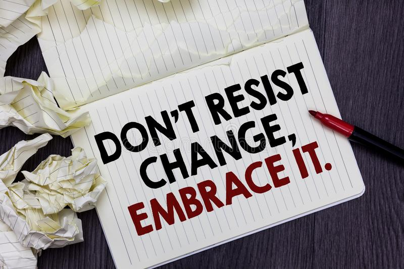 Writing note showing Don t not Resist Change, Embrace It. Business photo showcasing Be open to changes try new things positive Mar. Ker over notebook crumpled royalty free stock photo