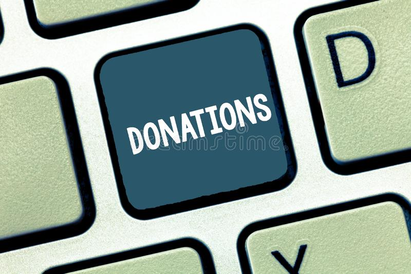 Writing note showing Donations. Business photo showcasing something that is given to charity especially sum of money. Keyboard Intention to create computer stock photography