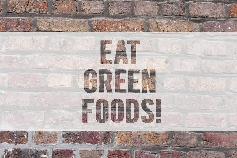 Writing note showing Eat Green Foods. Business photo showcasing Eating more vegetables healthy diet vegetarian veggie. Demonstrating Brick Wall art like royalty free illustration