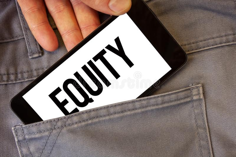 Writing note showing Equity. Business photo showcasing Value of a company divided into equal parts owned by shareholders Man hold. Ing cell phone white screen royalty free stock images