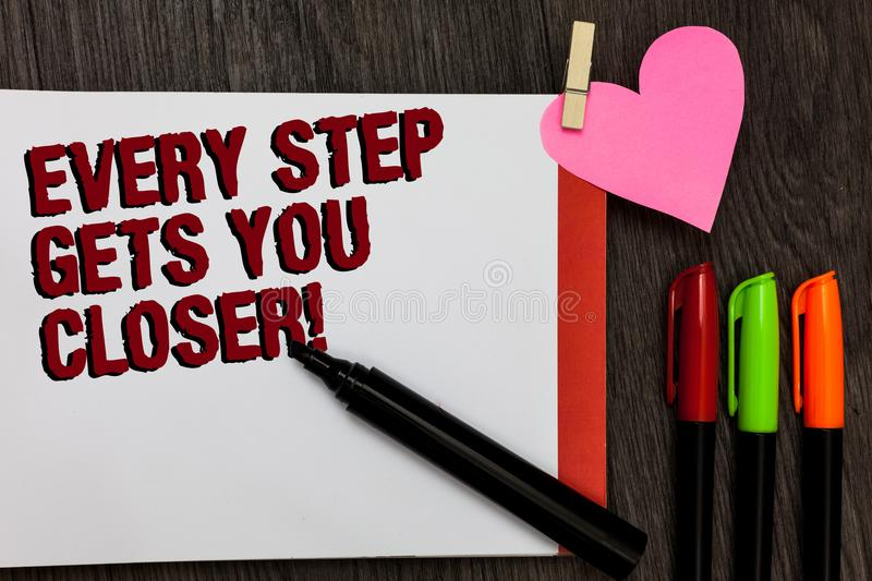 Writing note showing Every Step Gets You Closer. Business photo showcasing Keep moving to reach your goals objectives Bold red wor royalty free stock photos