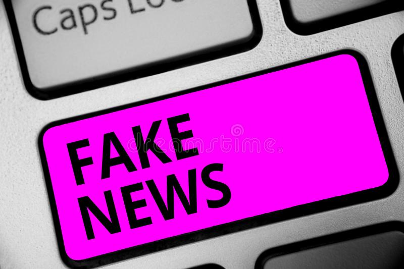 Writing note showing Fake News. Business photo showcasing Giving information to people that is not true by the media Keyboard purp. Le key Intention computer stock images