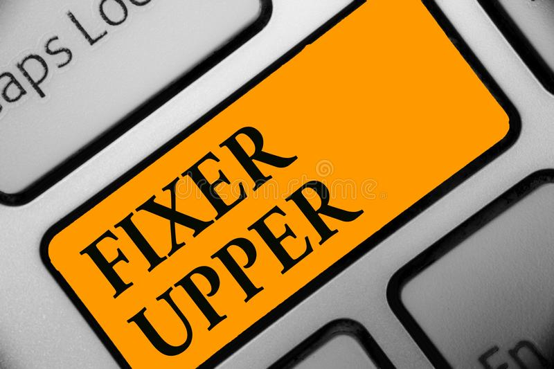 Writing note showing Fixer Upper. Business photo showcasing house in need of repairs used chiefly connection with purchase Keyboar. D orange key Intention stock image