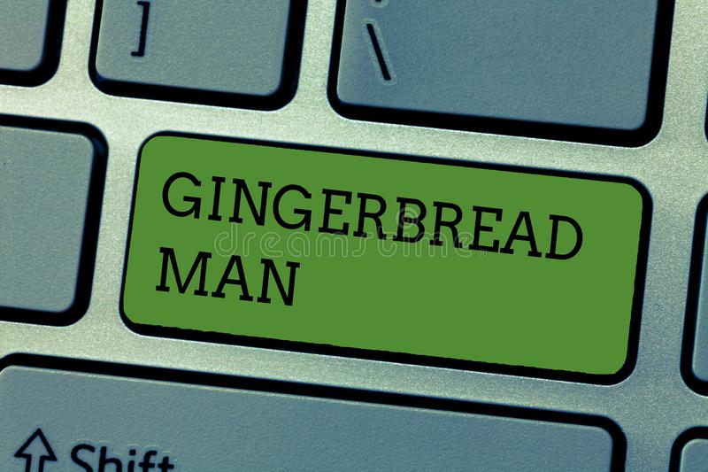 Writing note showing Gingerbread Man. Business photo showcasing cookie made of gingerbread usually in the shape of human.  stock image