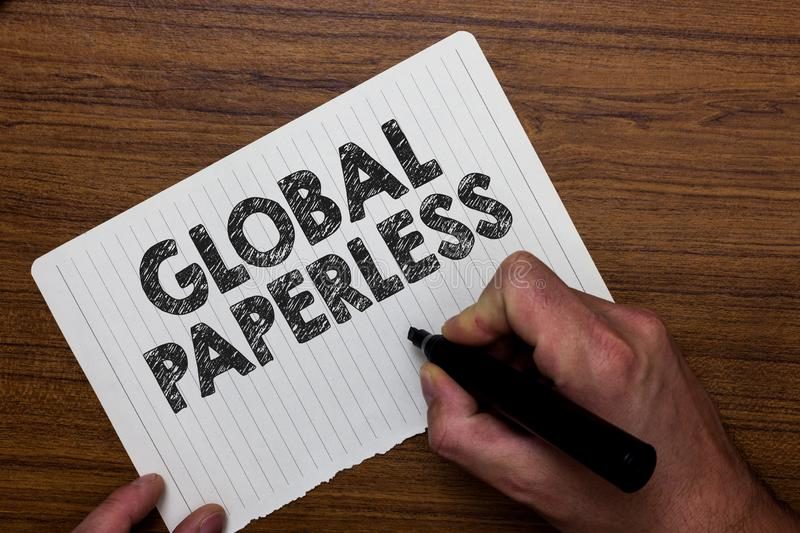 Writing note showing Global Paperless. Business photo showcasing going for technology methods like email instead of paper Man hol. Ding marker notebook paper royalty free stock photography
