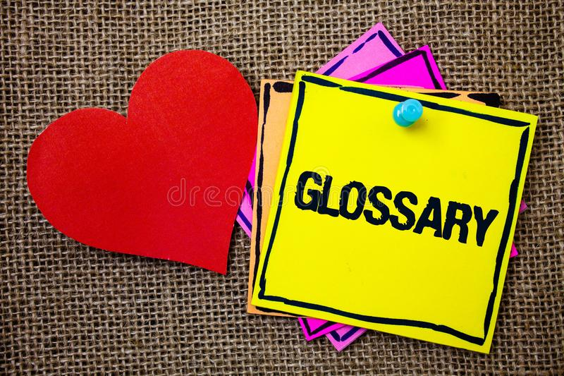 Writing note showing Glossary. Business photo showcasing Alphabetical list of terms with meanings Vocabulary Descriptions Ideas m. Essages paper papers red heart stock photo