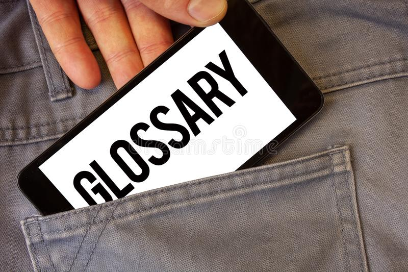 Writing note showing Glossary. Business photo showcasing Alphabetical list of terms with meanings Vocabulary Descriptions Man hol. Ding cell phone white screen stock photography