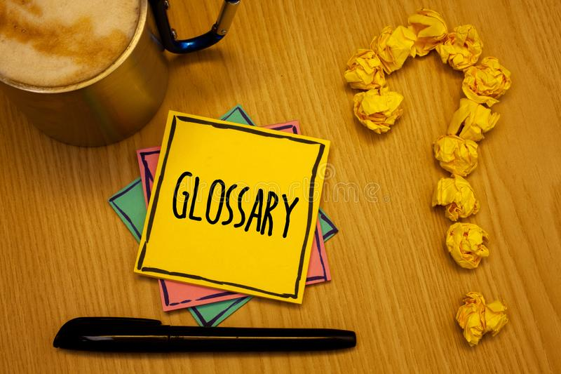 Writing note showing Glossary. Business photo showcasing Alphabetical list of terms with meanings Vocabulary Descriptions Message. Wood table coffee cup stock photos