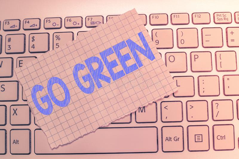 Writing note showing Go Green. Business photo showcasing making more environmentally friendly decisions as reduce recycle stock images