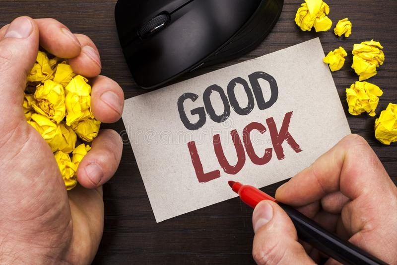 Writing note showing Good Luck. Business photo showcasing Lucky Greeting Wish Fortune Chance Success Feelings Blissful written by. Man Note Paper Holding Marker royalty free stock photos