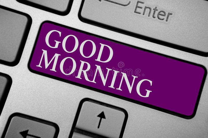 Writing note showing Good Morning. Business photo showcasing A conventional expression at meeting or parting in the morning Keyboa. Rd purple key Intention royalty free stock photo
