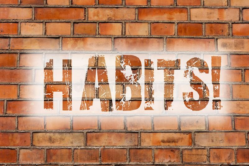 Writing note showing Habits. Business photo showcasing Regular tendency or practice Routine Usual Manners Behavior Pattern Brick. Wall art like Graffiti stock images