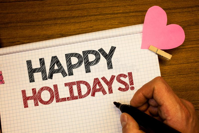 Writing note showing Happy Holidays Motivational Call. Business photo showcasing Greeting Celebrating Festive Days Man holding pe royalty free stock image