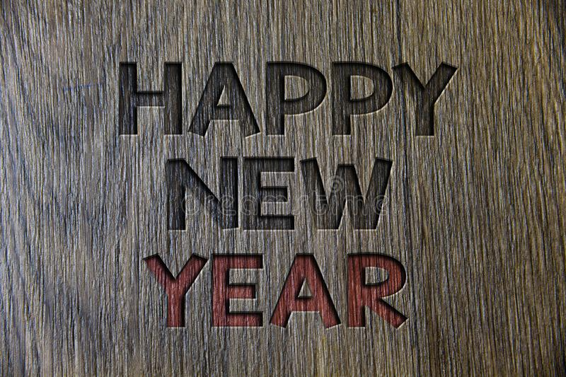 Writing note showing Happy New Year. Business photo showcasing congratulations Merry Xmas everyone beginning of January Wooden wo. Od background black engraved stock photo