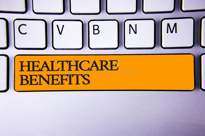 Writing note showing Healthcare Benefits. Business photo showcasing it is insurance that covers the medical expenses Keyboard key. Intention create computer stock photo
