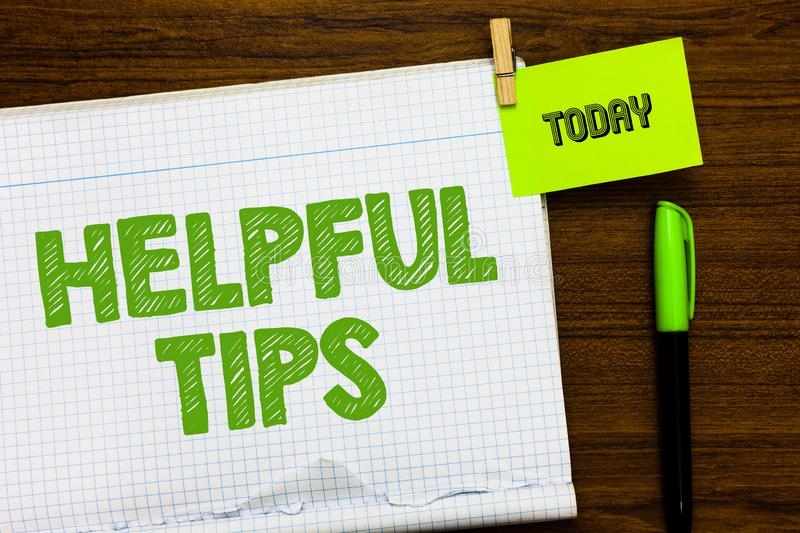 Writing note showing Helpful Tip s is. Business photo showcasing Ask an Expert Solutions Hints Consulting Warning Open. Notebook page markers holding paper stock photos